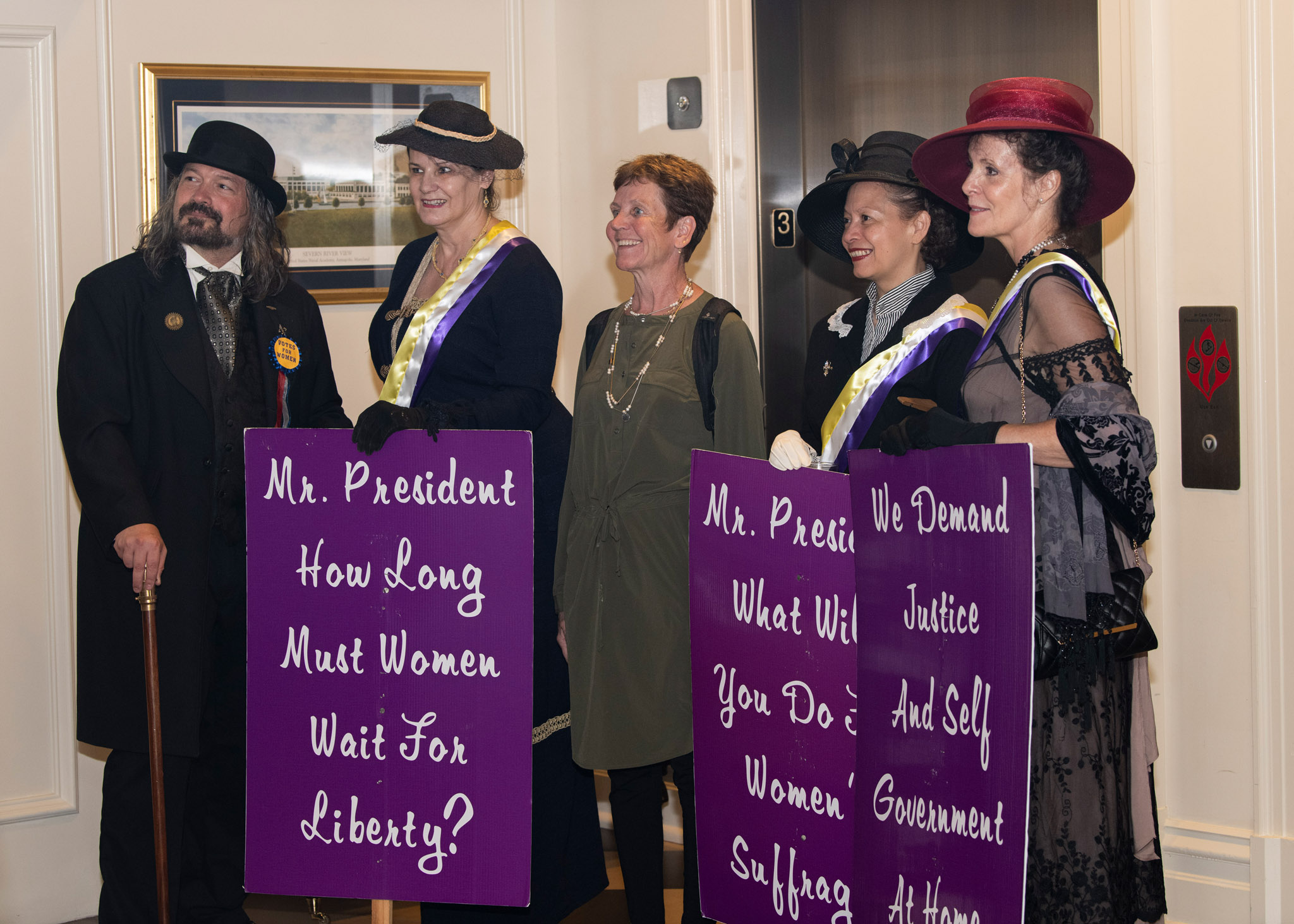 01d-The-Ladies-suffragist-reenactors-greet-guests-as-Honoary-Board-member-Patsy-McDonald-joins-in