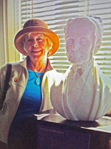Photo of Patricia A. McCarthy with bust of Lucretia Mott at the Sewall Belmont House by Robbie Morris.