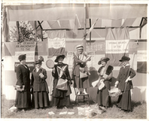 Sophie Meredith (2nd from left) with Virginia Branch of the Congressional Union attract attention at Virginia State Fair in Richmond.